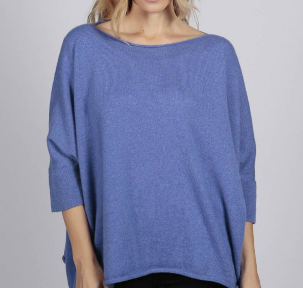 Woman in blue cashmere sweater