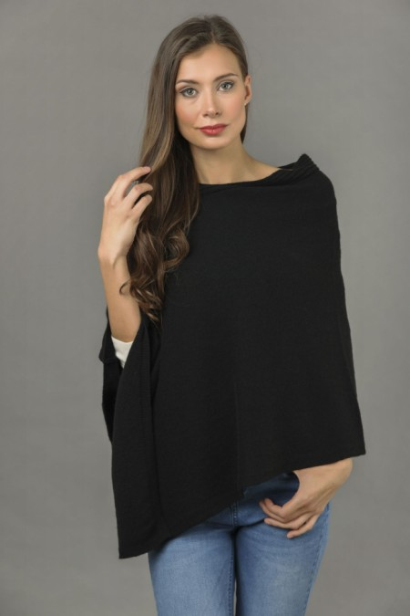 Pure Cashmere Knitted Asymmetric Poncho Wrap in Black front 1