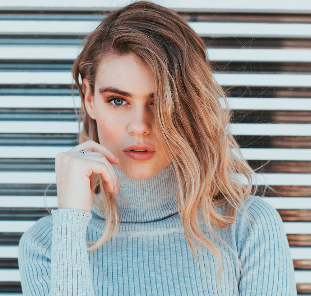 Woman in a cashmere turtleneck jumper