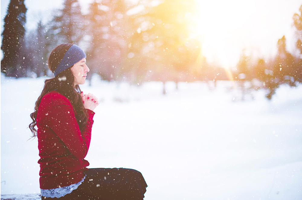 Woman in the snow with a jumper