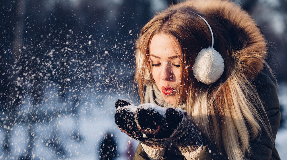 Woman in cashmere in the snow